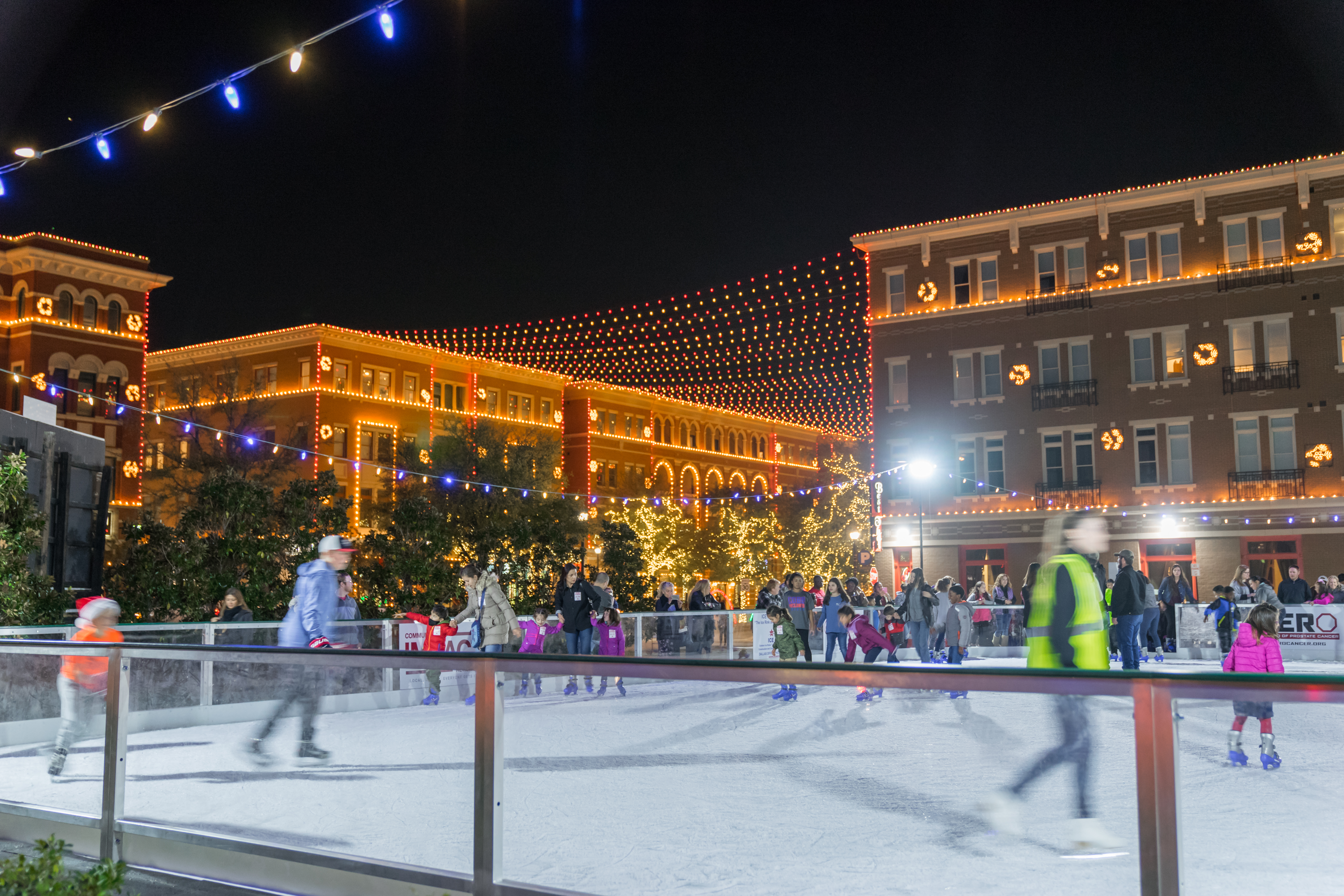 People participate in Christmas In The Square by skating on the skate rink.