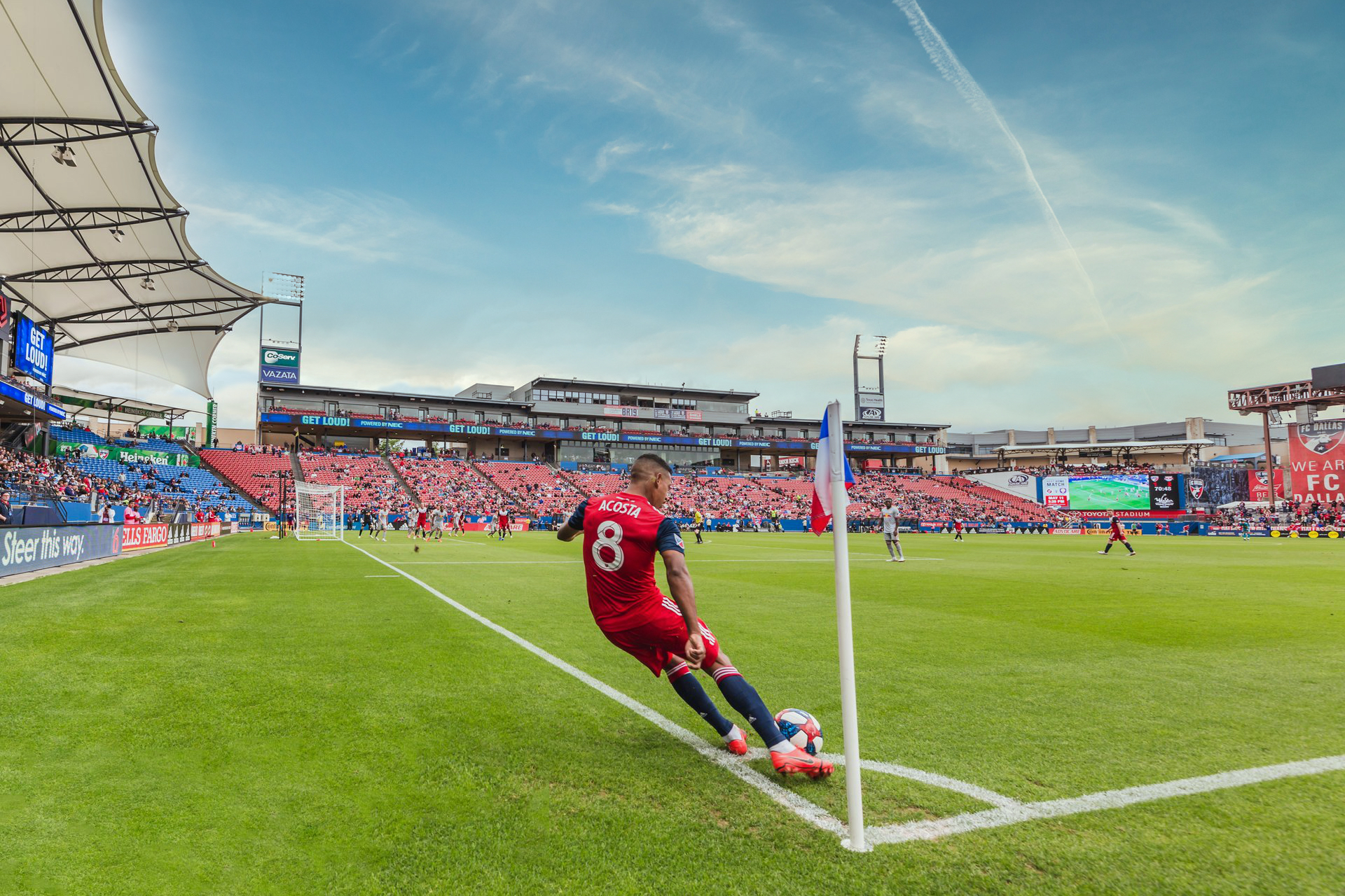 A soccer player performs a corner kick at Toyota Stadium.