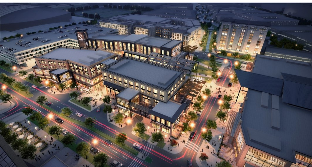 Aerial rendering of Frisco Station. There are shops, apartment buildings, and a parking garage.