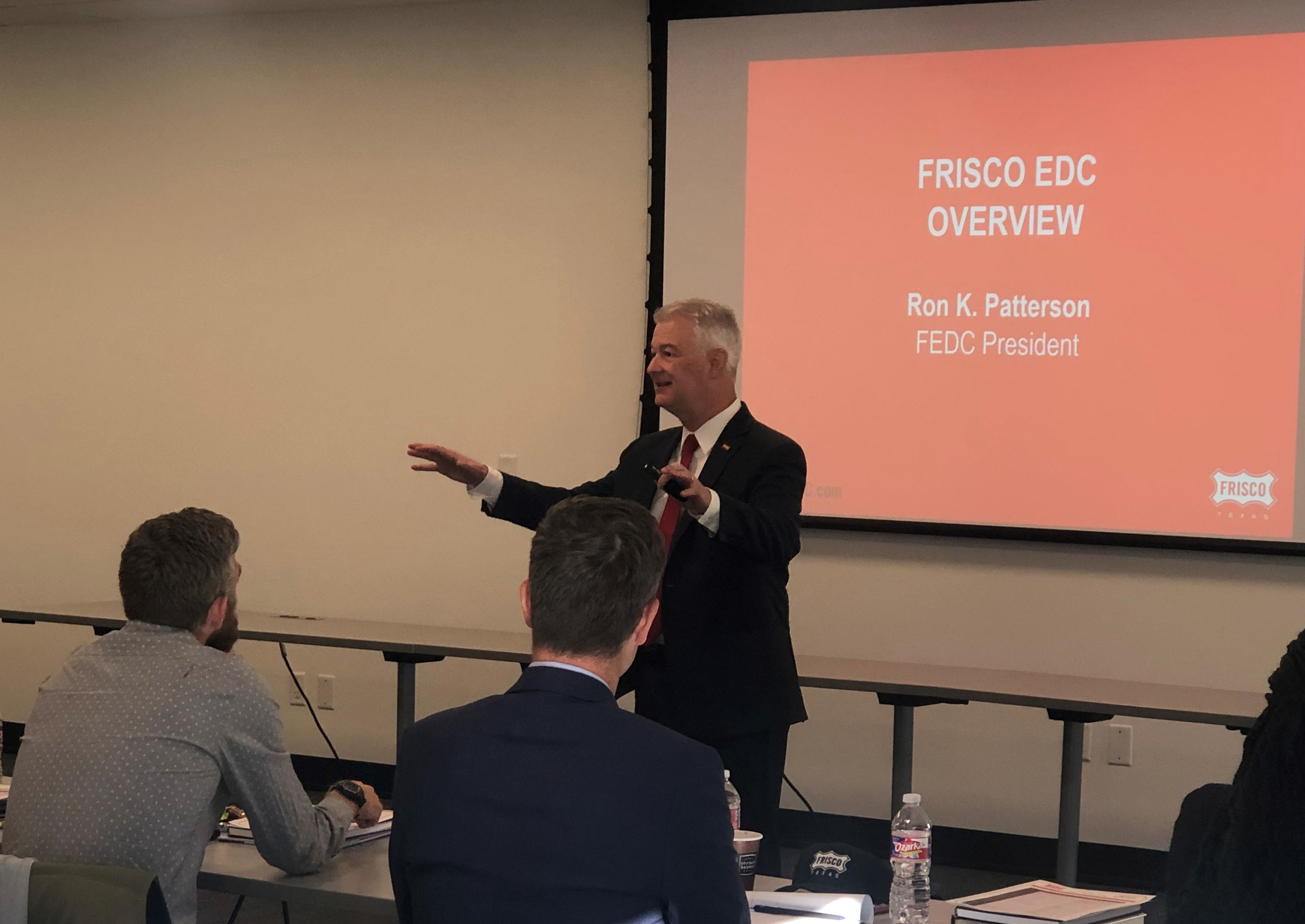 Frisco EDC President Ron Patterson speaks to a group in a classroom