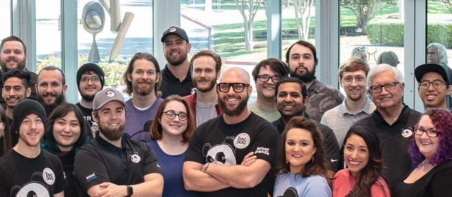 Employees at Asset Panda gather for a posed photo.