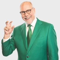 Dr. Neal Smatresk wearing a green suit holding up his right hand in the shape of a claw representing the University of North Texas