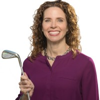 Sandy Cross poses with a golf club.